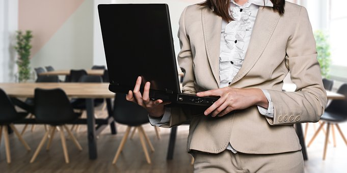 Image: Business Woman with Laptop Computer