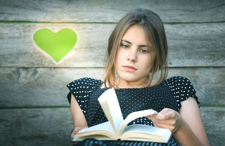 Image: girl reading a book