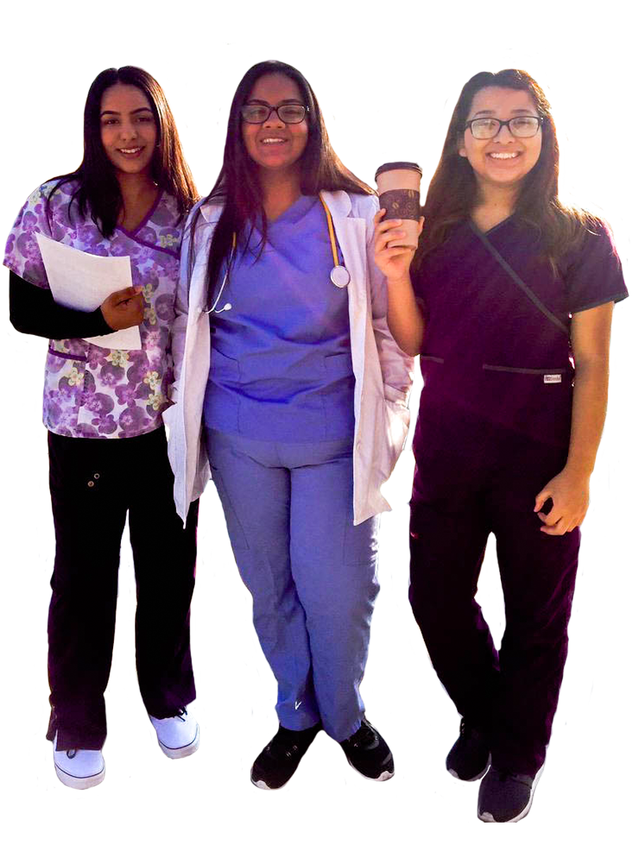 Three Livingston High female students dressed in nursing clothing.